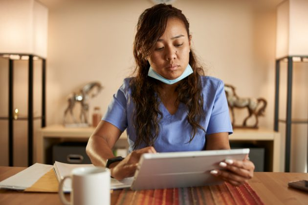 travel nurse reviewing contract cancelation