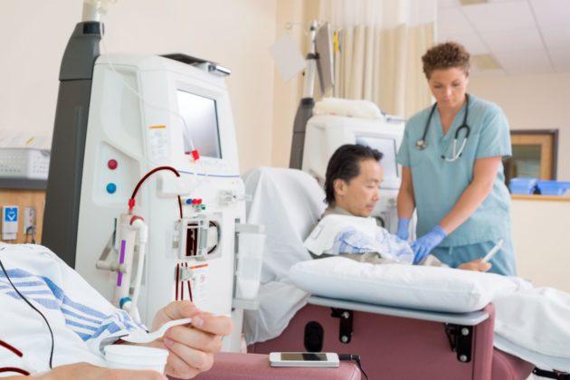 nurse performing emergency dialysis on patient